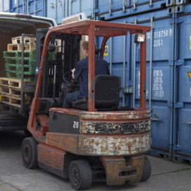 Fork lift truck loading pallets on to van